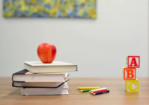 apple on books on desk