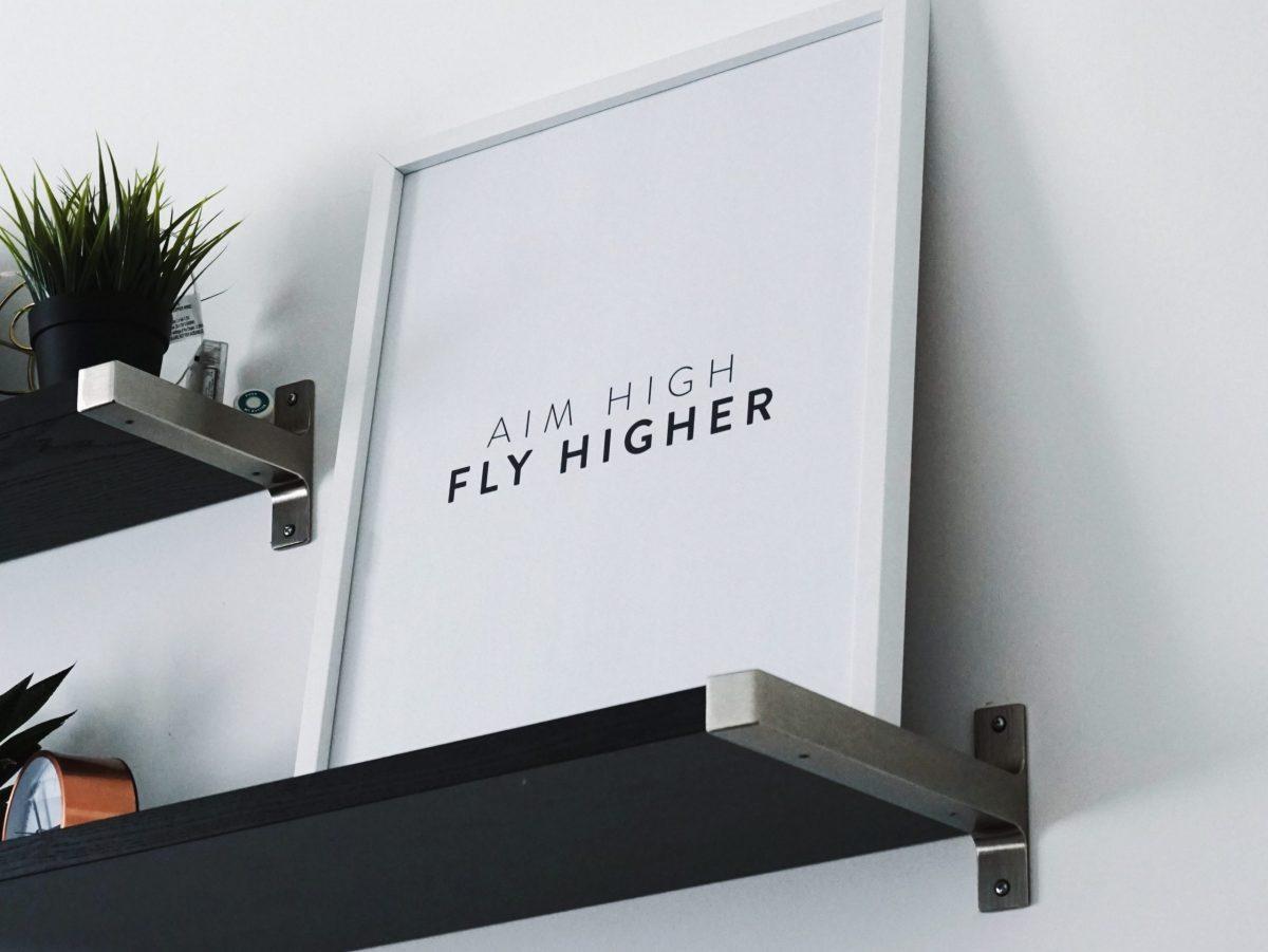 framed art stating aim high, fly higher